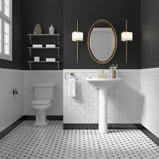 white subway wall tile with black and white penny floor tiles