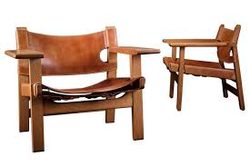 pair of lounge chairs spanish chair oak frame and stitched saddle leather