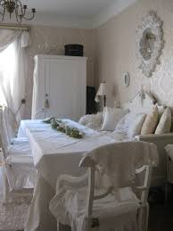 Rectangular Dining Table With White Tablecloth And White Wooden