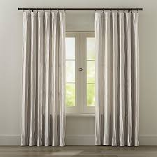 curtain panel features casual stripes of ivory and natural chambray cotton enhanced with ivory stitching along the vertical creating virtual pleats for