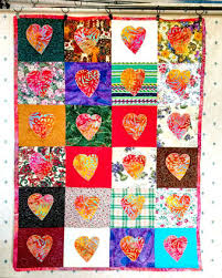 Random Acts of Kindness in quilting - Rocksprings Crafts & quilt made of small squares, each square containing an applique heart Adamdwight.com