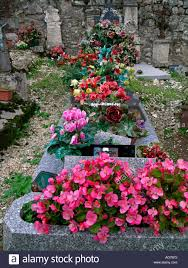 Grave Decoration Real And Artificial Flowers As Grave Decoration Stock Photo