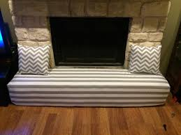 fireplace cover child proofing the stone hearth gray and white stripes and chevron print pillows