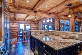 luxury kitchen in log cabin with island granite counter and travertine tile