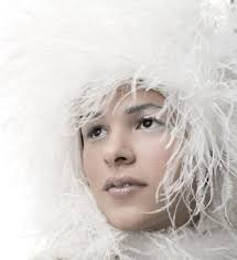 woman with white feathery hat and white makeup professional photography nyc