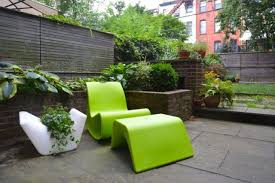 lime green patio furniture. sculptural lime green chair with a foot rest for minimalist space patio furniture