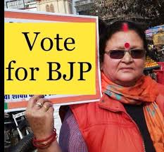 Image result for kanpur-bjp-mayor-candidate-pramila-pandey-with revolver