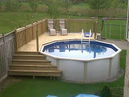 Pool Deckwith Left Stairs Meeting Lower Deck And Also On Right Side The Maintenancestorage Area