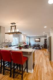 This contemporary kitchen remodel creates a beautiful open layout  connecting the kitchen, dining, and