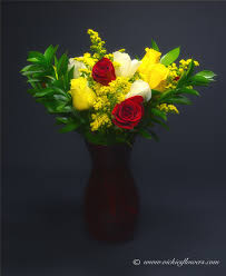 roses r 006 65 plus tax and delivery bright and cheery colorful arrangement of one dozen mixed red roses white roses