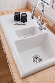 white kitchen sink. Reginox Overmounted Ceramic Sink With Drainer - 1.5 Bowl (Reversible) White Kitchen