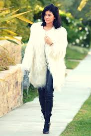 get the look kylie jenner in all black leather leggings and white faux fur