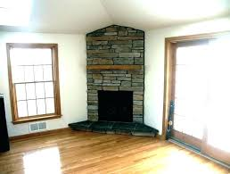 electric fireplace ideas with above corner stone stacked idea