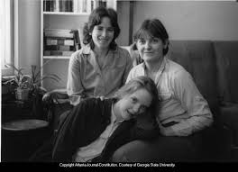 "Lesbian family: Anne Rhodes (right), daughter Satya, and Claudia Brenner,  in documentary ""Not All Parents Are Straight,"" Ithaca, New York, 1987. -  Atlanta Journal-Constitution Photographs - Georgia State University Library  Digital Collections"