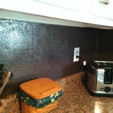 faux kitchen tile wallpaper. faux tin wallpaper painted with rubbed bronze spray paint for backsplash! plastic tiles in kitchen tile