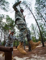 u s department of defense photo essay a reserve ier dismounts from a balance obstacle as part of a team building confidence