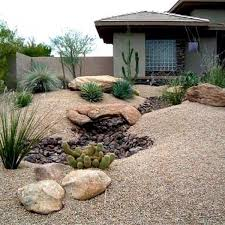 A faux rock stream adds visual interest to a plain rock yard.