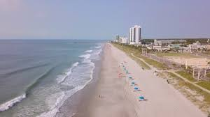 Flyover Along The Beach With Hotels In Background In Myrtle Beach South Carolina