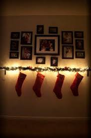 No fireplace? Hang up stockings on empty wall with command strips, then  cover up the command strips with a garland  | For the home | Pinterest |  Command ...