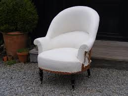 large tub chair covered in calico with casters height 96cm width 84cm depth