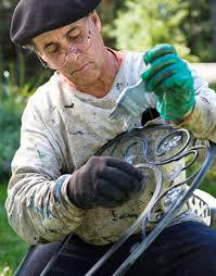 painting wrought iron furniture. man painting chair wrought iron furniture i
