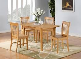 solid unfinished wood kitchen table and chair set with centerpiece