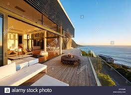 modern luxury patio with fire pit and ocean view stock image h61 luxury