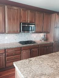 over nice cherry wood cabinets is there anyway to keep the cur cabinets and give this kitchen a fresh look or should we paint the cabinets white