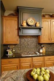 paint color with golden oak cabinets. (cork flooring)-best paint colours for yellow orange or golden oak cabinets the walls include darker green like benjamin moore sharkskin and cromwell color with n
