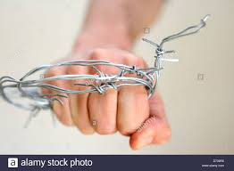 Fist in barbed wire
