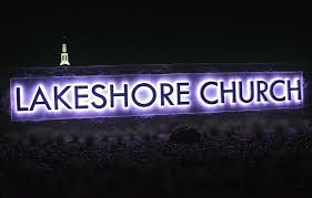 reverse lighted channel letters with color changing rgb lights mounted on monument sign