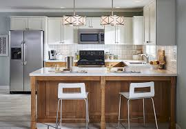 white and brushed nickel drum pendants in a traditional kitchen