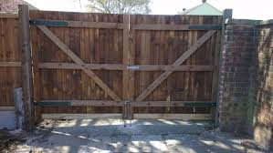 pair of custom gates with drop bolts in chelmsford