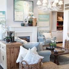 hamptons bedroom furniture. mantel, blue lounge with white cushions. hamptons bedroom furniture