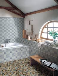 multi color bathroom mosaic floor tile with white built in bathtub and top curved window