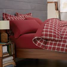 amusing wall decor with flannel duvet cover and wood bed frame plus nightstand and table lamp