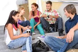Teens Collage Students Laughing On School Stairs In Break Teens College Relaxing