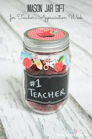 grab some sbook embellishments a mason jar and some candy to create this mason jar