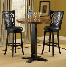casual style dining room decor with 3 pieces round black pub table set black vinyl chair cushions and 30 inch hilale dynamic stools seat height