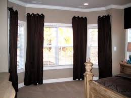berber carpet with baseboard and elegant dark curtain plus crown molding also bay window curtain rods