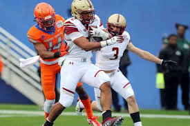boston college running back aj dillon 2 scores a touchdown ahead of boise state