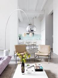 antique metal floor lamp in living room with vintage sofa design mix and match shades decorating