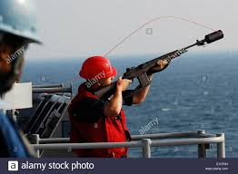 U S Navy Gunners Mate 3rd Class Joshua A Spooner Prepares To Fire