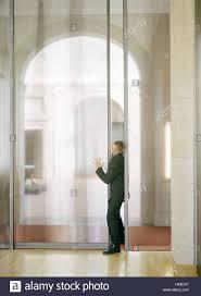 office sliding door. Office Buildings, Sliding Door, Businessman, Press, Force, Side View, Man, Manager, Glass Doors, Push, Delay, Late, Unpunctuality, Door A