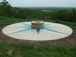 stained concrete fire pit with compass rose