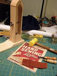 i ordered a set from tandy that included the basic tools a copy of the art of hand sewing leather by al stohlman the tandy leather co 1977