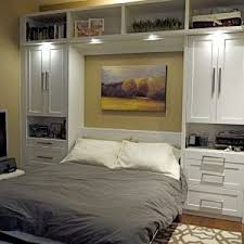 overhead bedroom furniture. Bedroom. Superb White Cabinets For Tiny Home Interior Space Idea Feat Modern Murphy Bed With Overhead Lighting Design. Bedroom Furniture