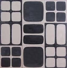above popham design s squarish tiles comes in five pattern variations three of them are shown here the 20 by 20 centimeter cement tiles are made outside