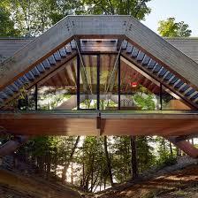 Bridgehouse by Llama Urban Design spans over Canadian forest floor