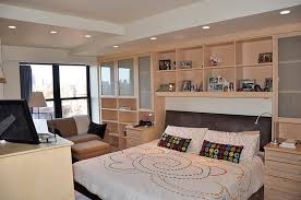 bedroom wall unit furniture. Bedroom Cabinetry Surrounds Bed And Covers An Entire Wall With Storage Solutions Unit Furniture